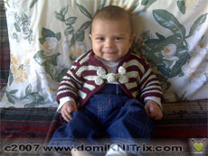 Aakash in the Mandarin Baby sweater